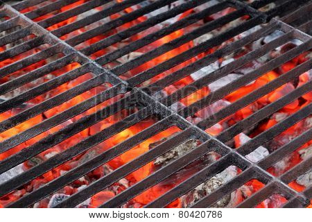 Empty Bbq Grill And Glowing Hot Coals