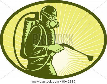Pest control exterminator worker spraying