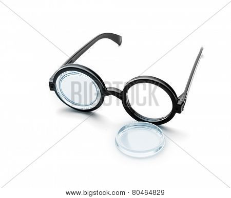 Broken black round glasses isolated on white