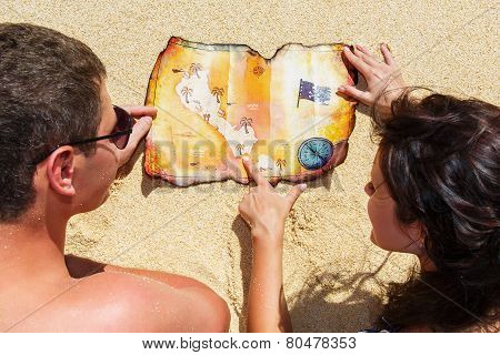Happy Young Couple Having Fun On The Shore Of A Tropical Island. Summer Vacation Concept.