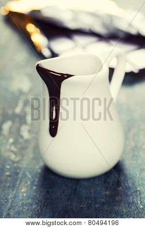 Delicious rich and thick chocolate sauce in a jug - food and drink