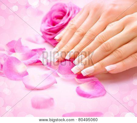 Manicure, Hands spa Beautiful woman hands, soft skin, beautiful nails with pink rose flowers petals. Healthy Woman hands. Beauty salon. Beauty treatment.  Female nails with beautiful french manicure  poster