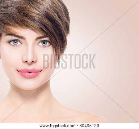Beautiful young spa woman with short hair portrait. Attractive girl Face with perfect Clean Fresh Skin close up. Beauty model. Blue eyed Lady Smiling. Youth and Skin Care Concept