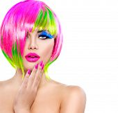 Beauty Fashion Model Girl with Colorful Dyed Hair, pink nails. Haircut with fringe. Colourful short Hair. Portrait of Beautiful Girl with Dyed Hair, professional hair Coloring. Colouring hair  poster