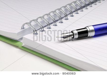 Fountain pen on notebook