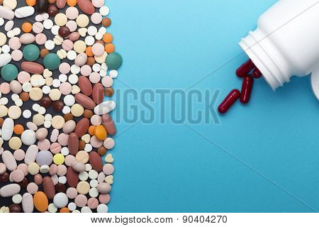 Different pills and bottle with copy space