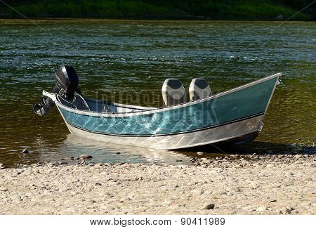Drift fishing boat on the shore of the Umpqua River