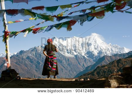 Nepalese Woman And Langtang Peak