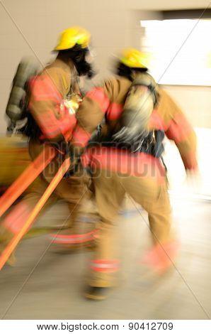 Fire fighers dragging hose