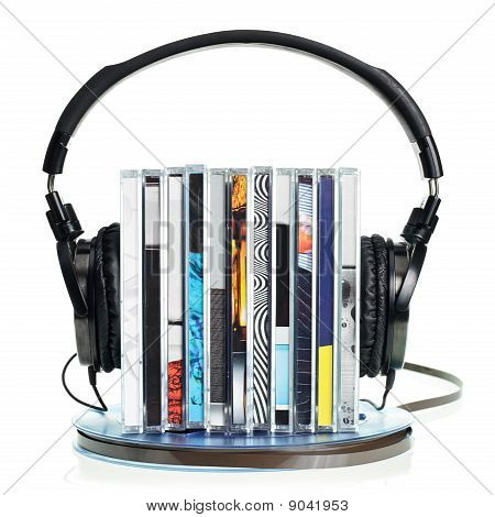 Headphones On Stack Of Cds And A Reel Tape