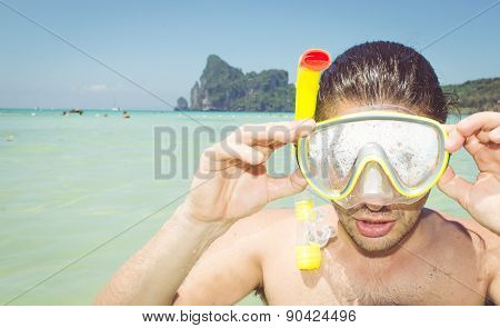 Man With Scuba Mask In Clear Sea