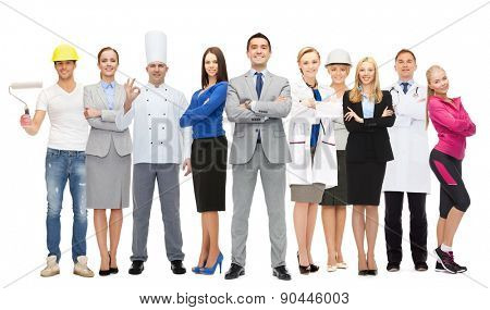 people, profession, qualification, employment and success concept - happy businessman over group of professional workers