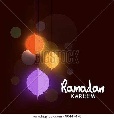 Shiny hanging paper lanterns, concept for Islamic holy month of prayers Ramadan Kareem celebrations.
