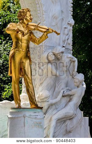 the johann strauss monument stands in the stadtpark.