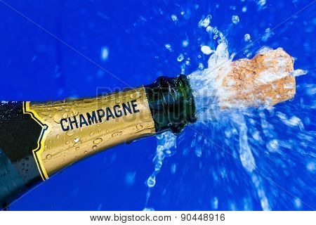champagne bottle is opened. cork shoots from champagne bottle. symbolic photo for the year, new year's eve, celebrations and openings.