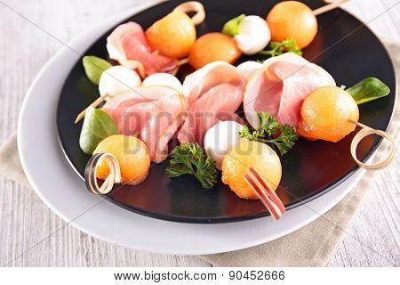 buffet food with melon,mozza and prosciutto