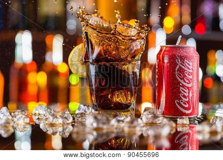 Prague, CZECH REPUBLIC - MAY 11, 2015 : Can of Coca-Cola with glass splash on ice cubes. Coca-Cola is the one of the worlds favourite soft drinks.