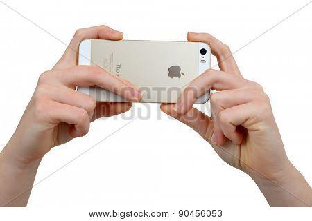 Plzen,Czech Republic - December 5, 2014 : Woman Hand Holding Apple iPhone 5S Smart Phone