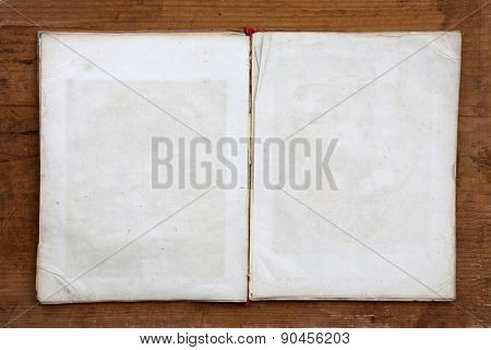 empty book on wooden background.