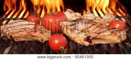 Pork Rib Steaks, Tomato And Mushrooms On Hot Bbq Grill