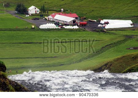 Farm in a green valley in Iceland