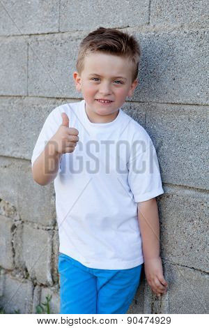 Smiling boy with blue eyes about 5 years looking at camera and saying Ok