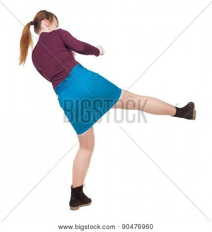 skinny woman funny fights waving his arms and legs. Rear view people collection.  backside view of person.  Isolated over white background. Angry woman in a fight.