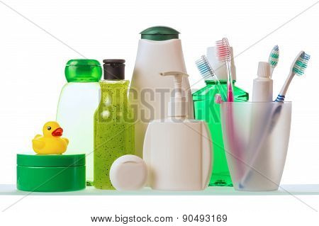 Shampoo, dental floss and toothpaste with toothbrushes isolated on white background poster
