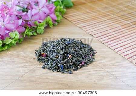 Blend Of Green Tea On A Table With Colours2.