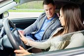 Driving instructor and woman student in examination car poster