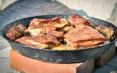 Cooking of traditional balkan turkish bosnian dalmatian meal Peka in metal pots called sac sach or sache. Traditional roast of pork beef or veal poster