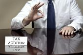 IRS tax auditor business card sitting at desk with hand showing OK sign for audit success poster