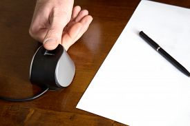 Finger Scanning On The Table Beside Paper And Pen