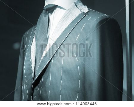 Store Clothes Dummy In Suit Shop