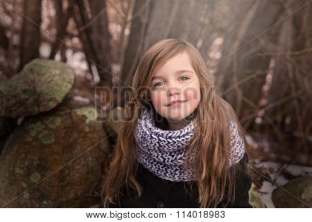 portrait of a beautiful little girl laying outside
