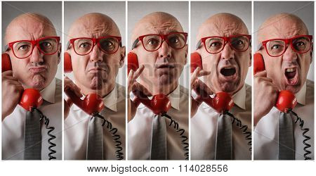 Angry man answering the phone