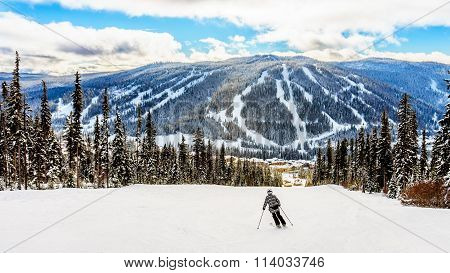 Skiing down to the village of Sun Peaks