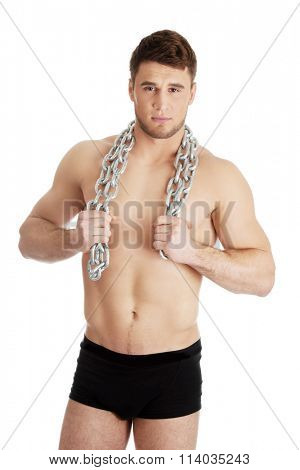 Well build male model with chains over his neck.