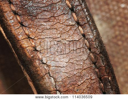 Close-up Of Old Stiches In Leather