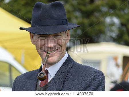 A man dressed in 1940s fashion