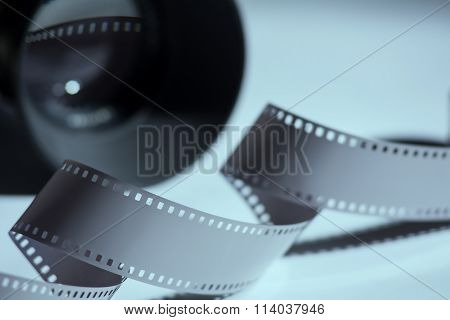 Close-up Reel Of Film And Spun In The Background Camera Lens