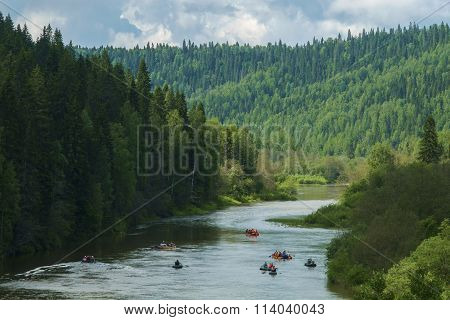 Mountains river and rafts