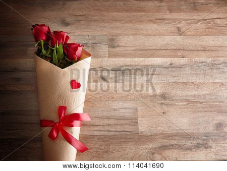 red roses on wooden background. the concept of love and Valentine's day.