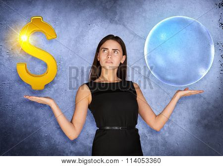 Busineswoman holding dollar sign and big bubble