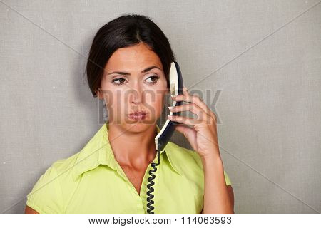 Customer Service Lady Weary While Holding Phone