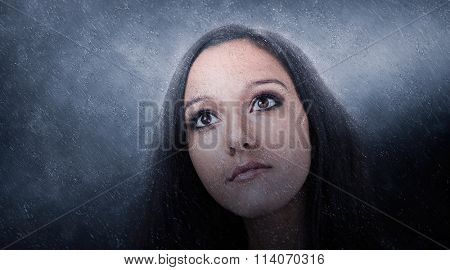 Panoramic Close Up Portrait of Young Girl with Dark Hair and Wide Eyes Illuminated in Soft Dramatic Spotlighting and Photographic Effect Overlay and Copy Space