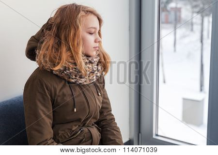 Beautiful Blond Caucasian Teenage Girl In Warm Outwear