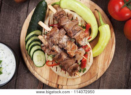 Souvlaki or kebab, grilled meat skewer with pita bread