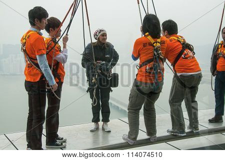 People training before bungee jump and sky walk at Macau Tower