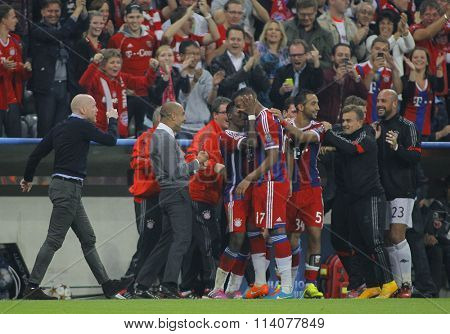 MUNICH, GERMANY - SEPTEMBER 17 2014:  Pep Guardiola celebrates with players during the UEFA Champions League match between Bayern Munich and Manchester City, at the Allianz Arena, Munich, Germany.